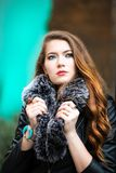 Photo of a Woman Holding Her Black Furry Scarf royalty free stock image