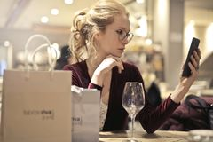Photo of Woman Holding Her Phone Stock Images