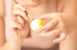 Photo of woman holding white egg and painting Royalty Free Stock Image