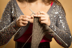Photo of woman knitting woolen scarf with needles Royalty Free Stock Photos
