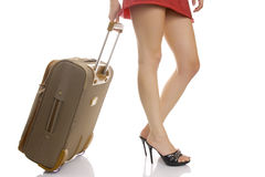 Photo of the woman legs with a suitcase. Royalty Free Stock Photo