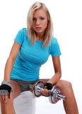 Photo of a woman lifting a weight. A photo of a woman lifting a weight Royalty Free Stock Image