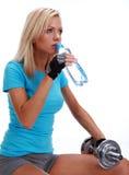 A photo of a woman lifting a weight. Studio shot Stock Photos