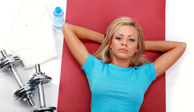 A photo of a woman lifting a weight. Studio shot Royalty Free Stock Photos