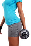 Photo of a woman lifting a weight. A photo of a woman lifting a weight Royalty Free Stock Photography