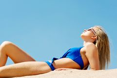 Photo of a woman lying on the beach Stock Photography