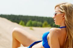 Photo of a woman lying on the beach Royalty Free Stock Images