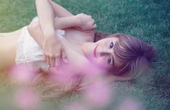 Photo of a Woman Lying on Green Wearing White Top Royalty Free Stock Image