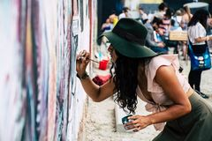 Photo of Woman Painting on Wall stock images