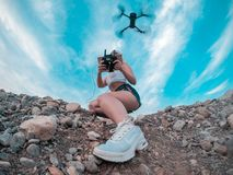 Photo Of Woman Playing With Drone Quadcopter Under Blue Sky royalty free stock images