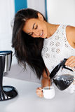 Photo of a woman pouring coffee from a glass pot Stock Photography