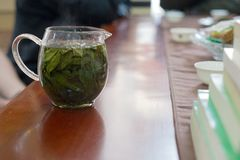 Tea ceremony in chinese restaurant, brewing green tea royalty free stock photos