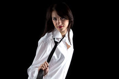Photo of woman pulling tie Stock Image