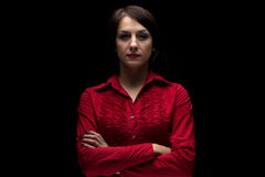 Photo woman in red shirt with arms crossed Royalty Free Stock Photo