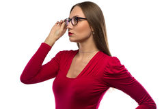 Photo of woman in red touching glasses Royalty Free Stock Photo