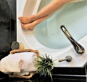 Photo of woman relaxing in bathtubs after work stock images