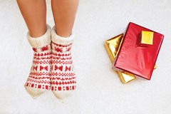 Photo of woman's feet with christmas socks, top view point Stock Photography