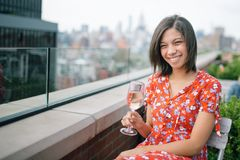 Photo of a Woman Sitting on Chair Holding Wine Glass stock photography