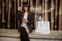 Photo of Woman Sitting Near Paperbag Royalty Free Stock Photo