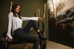 Photo of Woman Sitting on Wooden Chair Royalty Free Stock Photo
