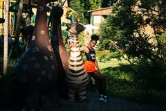 Photo of Woman Sitting on Zebra Statue Stock Photos