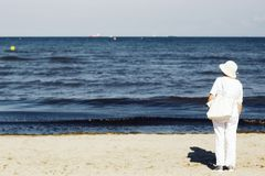 Photo of Woman Standing on Seashore stock photo