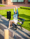 Photo of woman stretching on bench at park Royalty Free Stock Photo
