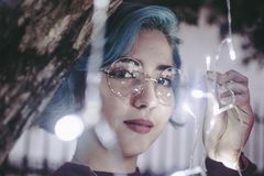 Photo of Woman in Sunglasses Holding String Lights stock image
