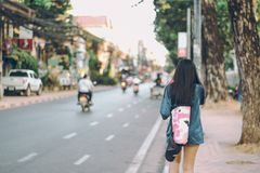 Photo of Woman Walking in the Street Royalty Free Stock Images