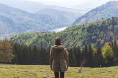 Photo of Woman Wearing Jacket Standing Near Forest Trees