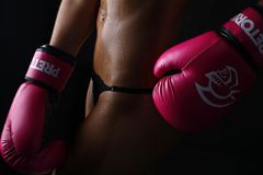 Photo of Woman Wearing Pair of Red Training Gloves stock images