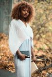 Photo of Woman Wearing White Dress and Holding Black Purse royalty free stock photos
