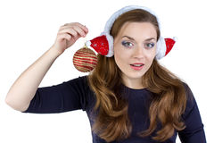 Photo of woman in winter headphones with ball Stock Image