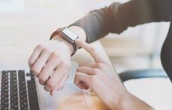 Photo Woman Working Modern loft,Using Generic Design Smart Watch.Female Finger Touching Screen Smartwatch.Account Manage Royalty Free Stock Photo