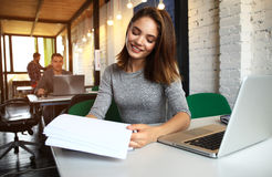 Photo woman working with new startup project in modern loft. Generic design notebook on wood table Stock Images