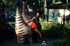 Photo of Woman Beside Zebra Statue Stock Photography