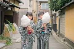 Photo of Women Holding Cotton Candy