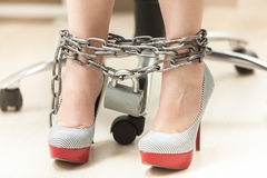 Photo of women legs in high heeled shoes locked by chain Royalty Free Stock Images