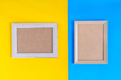 Photo wood frame on colorful paper wall background Stock Photo