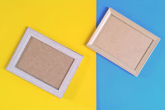Photo wood frame on colorful paper wall background Stock Images