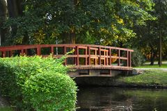 Photo of Wooden bridge over the river in summer park royalty free stock photos