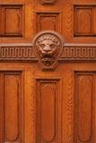 Photo of wooden door with lion head Royalty Free Stock Photo