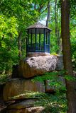Photo of wooden gazebo in a green park at summer royalty free stock photo
