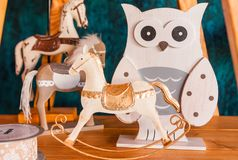 On a wooden shelf are toy horse and owl. Photo of  wooden shelf with  toy horse and owl stock photos