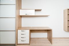 Photo of a wooden table and shelf