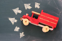 Photo of  wooden toy airplane over chalkboard Royalty Free Stock Photo