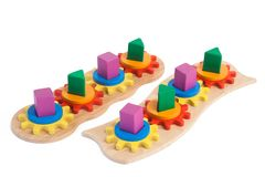 Photo of a wooden toy. Photo of a two wooden toys children`s sorter with small wooden details in the form of gears, in different colors for the development of royalty free stock photography