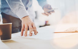 Photo work process banker.Man working wood table with new  business project.Modern laptop table.Pencil holding hand Stock Image