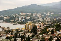 Crimea Yalta, Ukraine, city view landscape. Photo of Yalta Crimea, Ukraine from the Hill panorama, just before twilights in a cloudy day Royalty Free Stock Image