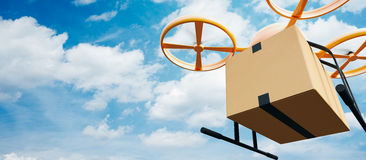 Photo Yellow Generic Design Modern Remote Control Air Drone Flying Empty Craft Box Under Urban Surface.Blue Sky Clouds Royalty Free Stock Photo